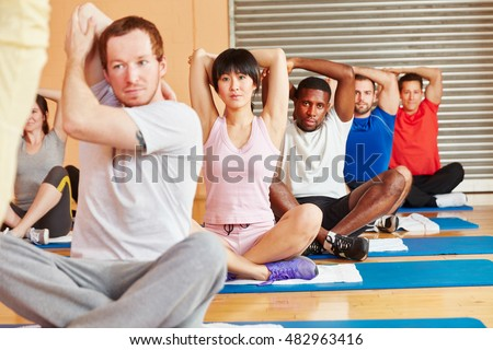 Group stretching in yoga class in a fitness center