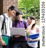 Group student with notebook at a campus - stock photo