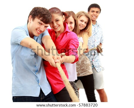 group students pulling on a length of rope. - stock photo
