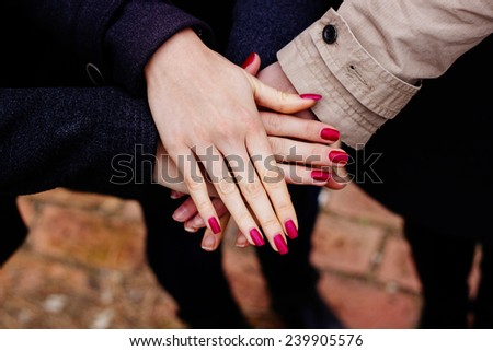 Group with hands together, friendship  - stock photo