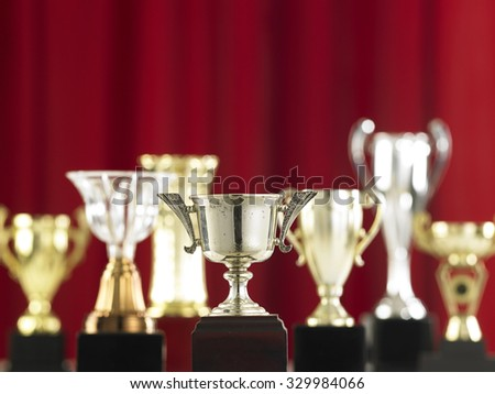 group with trophy in front of stage - stock photo