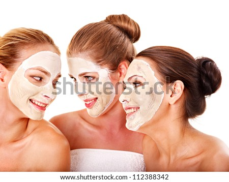 Group women with  facial mask in beauty spa. - stock photo