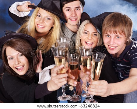 Group young people drinking champagne at nightclub.