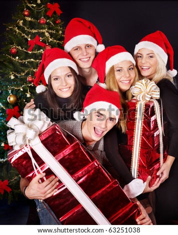 Group young people in santa hat drinking champagne at nightclub. - stock photo