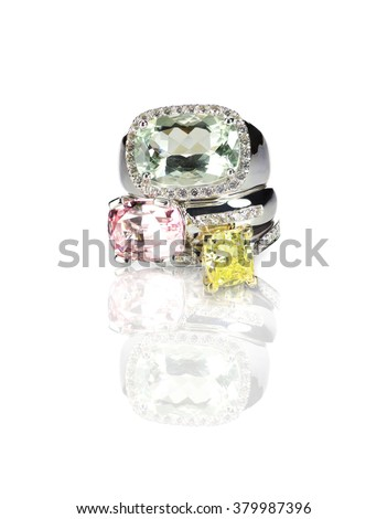 Grouping of colored gemstone diamond rings stacked - stock photo
