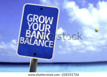 Grow Your Bank Balance sign with a beach on background