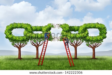 Growing a business partnership and repairing a connected network as a group of trees shaped as a broken chain link being fixed by two businessmen on ladders working together for a strong connection. - stock photo