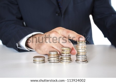 growing concept,business man with coins - stock photo