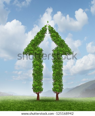 Growing group for partnership success as two trees in the shape of half an arrow coming together to form a whole upward symbol for financial wealth and high profits on a blue sky. - stock photo