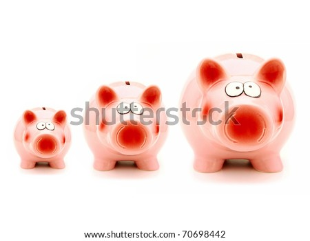 Growing investment - three piggy banks of increasing size isolated on white - stock photo