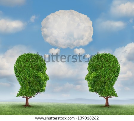 Growing network communication with a group of two trees shaped as a human head with a blank word bubble made of clouds as a business concept of team growth sending a message with cloud technology. - stock photo