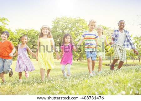 Grown Up Children Playing Sunshine Day in Park Concept - stock photo
