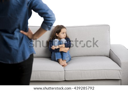 Grown up rebuking a little child for bad behavior - stock photo