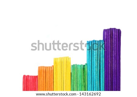 growth graph by ice cream stick on white background - stock photo