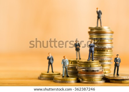 Growth money and business with your teamwork stack coin concept. - stock photo