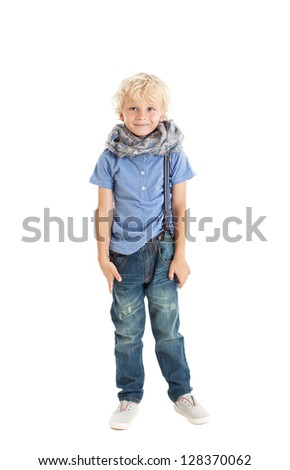 Growth portrait cute curly blond boy wearing a blue T-shirt, jeans, suspenders and Arabic scarf. Studio shot, isolated on white background. - stock photo