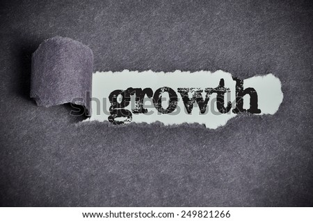 growth  word under torn black sugar paper  - stock photo