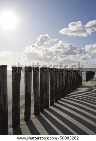 groynes at beach of baltic sea - stock photo