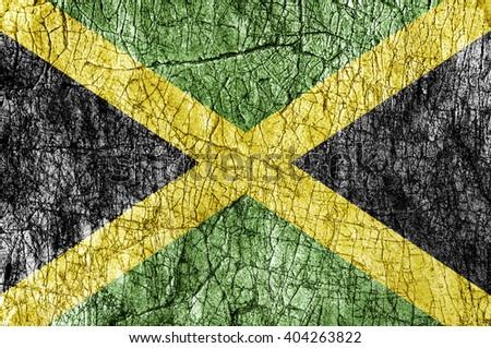 Grudge stone painted Jamaica flag - stock photo