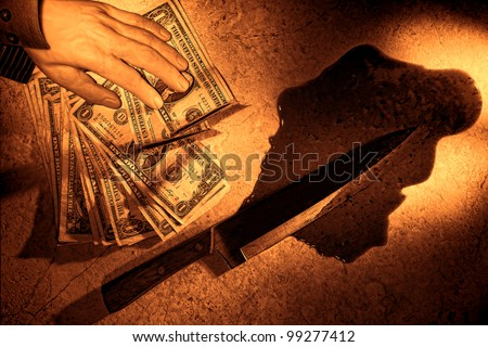 Gruesome forensic crime scene of violent murder with killed dead man hand holding stack of dollar bills next to bloody knife weapon in blood as criminal investigation evidence in rough grunge sepia - stock photo