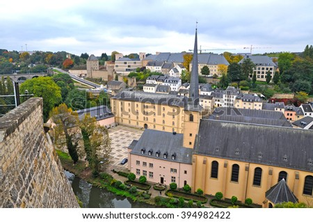 Grund district of Luxembourg City seen with Neumuenster Abbey and Alzette river