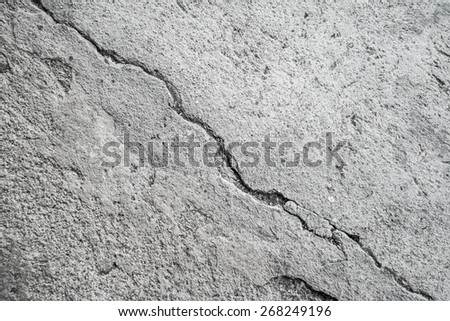 grunge and cracked cement wall - stock photo