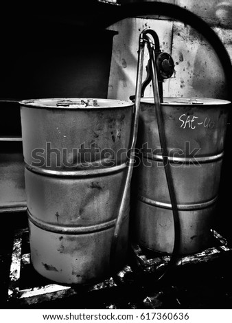 Grunge and noir of oil galvanized bin ,in factory.abstract design,black and white tone.