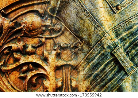 grunge background composing of vintage carved wood carving and old jeans