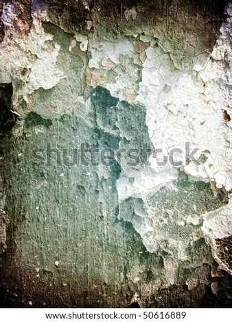 Grunge background, cracks and a paint on a concrete wall - stock photo