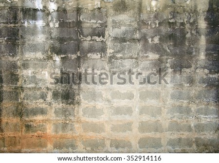 Grunge background, gray brick wall texture bright plaster wall and blocks road sidewalk abandoned exterior urban background - stock photo