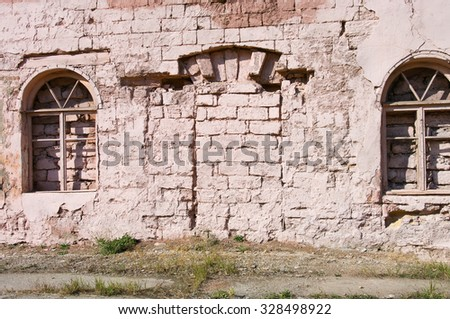 grunge background, red brick wall texture bright plaster wall and blocks road sidewalk abandoned exterior urban background for your concept or project - stock photo