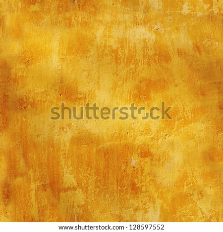 Grunge background - seamless texture stucco of ochre color - stock photo