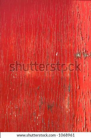 Grunge Background shot of a door with very cracked red paint