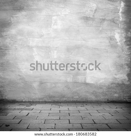 grunge background, white plaster wall texture gray sidewalk abandoned warehouse exterior urban background for your concept or project - stock photo
