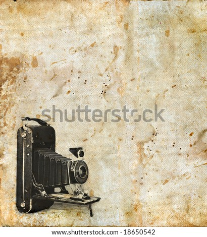 Grunge background with copy-space, an antique camera is in the corner.