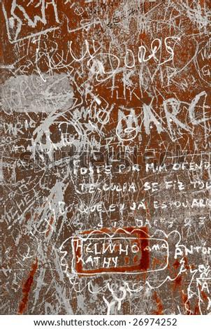 Grunge background with graffiti and writings on a rusty metallic surface - stock photo