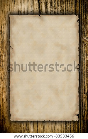 Grunge blank paper with wooden background - stock photo