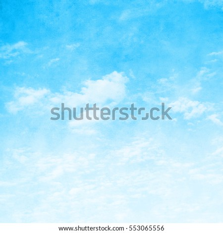 Grunge blue sky with clouds.