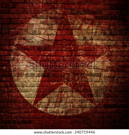 Grunge Brick Wall with Red Star Background - stock photo