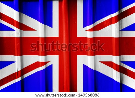 Grunge british flag background painted on the metal fence - stock photo