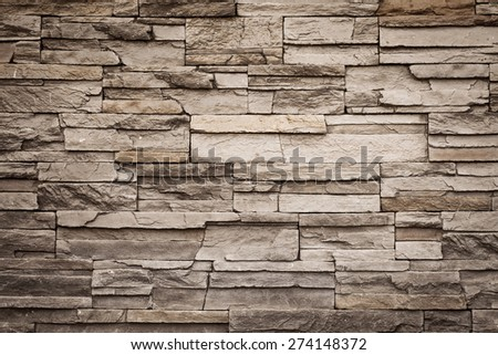 Grunge brown brick wall with copy space, vintage color tone - stock photo