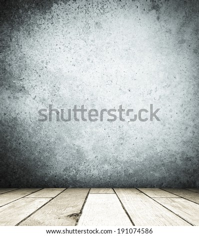Grunge cement wall and old wood floor, perspective view with lomo filter.