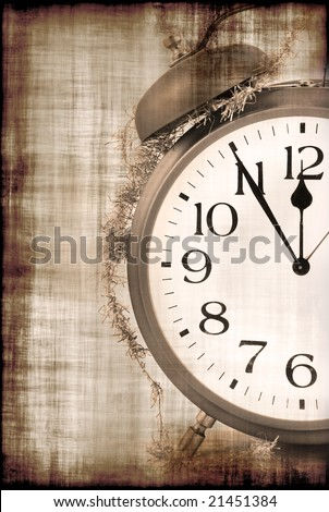 Grunge christmas background with old alarm clock and ribbon