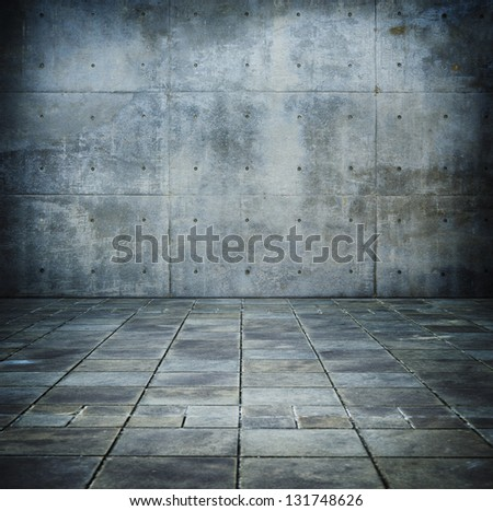 Grunge concrete room with tiled concrete floor - stock photo