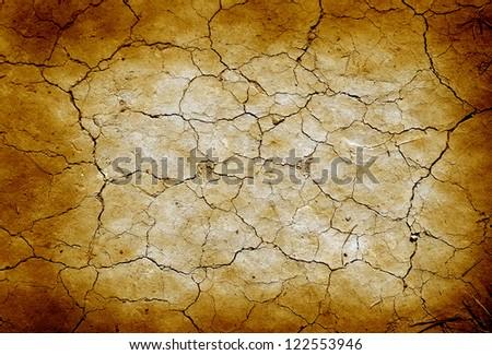 Grunge cracked earth in dry desert. - stock photo