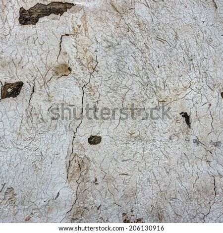 Grunge cracked old peeling concrete brick wall - stock photo