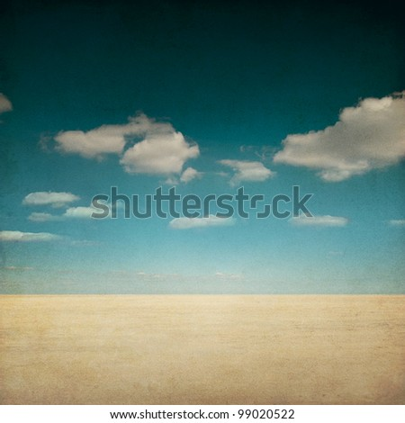 Grunge Desert landscape with clouds - stock photo