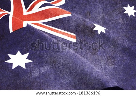 Grunge distressed aged old Australian flag for Australia Day, Anzac Day, 70th anniversary WWII, or 100th anniversary Gallipoli and start of WWI events. - stock photo