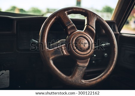 grunge effect classic car steering wheel  - stock photo