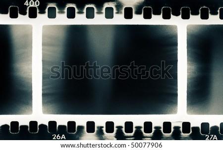 grunge film strip background with light leak - stock photo